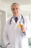 Male pharmacist holding a yellow medicine bottle