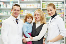 Mother and her child together with pharmacists