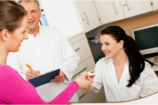Pharmacist accepting a piece of paper from a customer