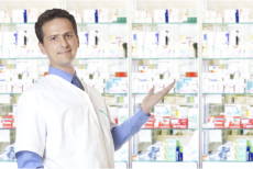 Male pharmacist showing a pharmacy shelf full of medical supplies